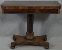 A Regency rosewood foldover top card table on facetted column and quatreform base. H.71 L.91 W.92cm