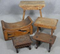 A carved Eastern neck rest along with a collection of four stools. H.45cm (tallest)