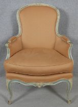 A Louis XV style carved and painted frame fauteuil in piped damask upholstery on cabriole