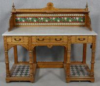 A late 19th century Aesthetic style walnut marble topped washstand with tiled upstand and platform