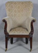 A Regency carved mahogany framed tub armchair in cut floral upholstery raised on square tapering
