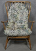 A mid century vintage beech framed lounge armchair with design registration stamp to the base. H.