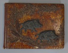 A Meiji period Japanese gilded lacquered and repousse copper work blotter with two wild boars