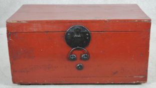 A vintage Chinese lacquered trunk with metal clasp and twin carrying handles. H.38 W.72 D.40
