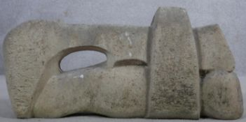 A craved hardstone sculpture of abstract form. H.32 W.70 D.15cm