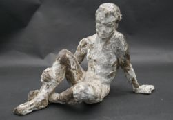A plaster figure on wirework frame, bronzed and patinated effect, seated figure. H.22cm