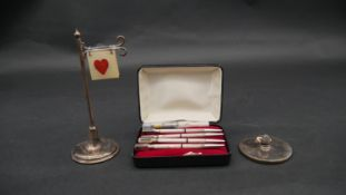 A silver and silver plate bridge set. Including a cased set of silver and enamel bridge marker/