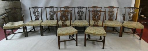 A set of ten 19th century mahogany dining chairs with pierced vase shaped splats above tapestry