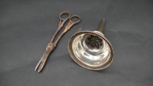 A sterling silver wine funnel and a pair of silver grape scissors with vine relief decoration.
