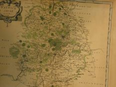 A framed and glazed Antiquarian map of Warwickshire engraved by Robert Morden with later hand