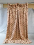 A pair of stylised floral design linen, lined curtains with repeating diamond pattern in cream, gold
