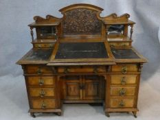 A late 19th century Dickens style desk by Thomas Turner of Manchester in oak and pollard oak with