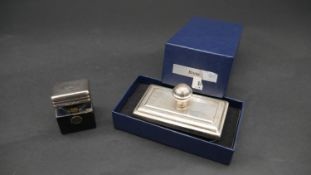 A boxed Silver blotter, hallmarked: Harrison Brothers & Howson Ltd, Birmingham 1896 and a silver