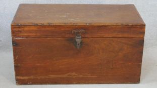 A 19th century camphor hinged lidded travelling trunk with twin iron carrying handles. H.40 W.77 D.