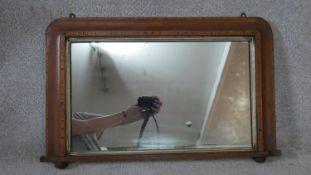 A 19th century Tunbridge inlaid overmantel mirror with original plate in gilt slip. H.47 W.74.5cm