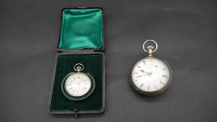 An American Elgin and Co silver plated bubble watch. With white enamel dial and engraved