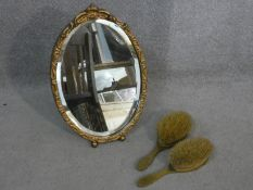 Two orange engine turned decorated guilloche enamel and brass brushes along with a carved gilt