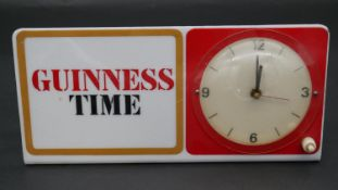 """A mid century vintage electric advertising clock with backlight that displays """"Guiness Time"""". H.14"""