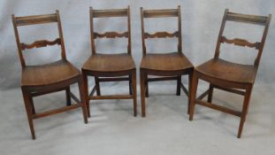 A set of four 19th century country fruitwood bar back dining chairs with panel seats on square