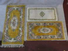 Two Chinese rugs with floral decoration on golden ground and a Persian style rug. L.160 W.78cm