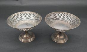 A pair of pierced silver bon bon dishes, marked Asprey, hallmarked London 1927. H.9cm, 248.7g (Total