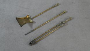 A set of 19th century embossed brass fire irons. L.71.5cm