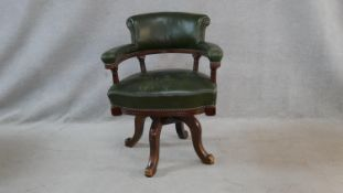 A 19th century mahogany framed captain's swivel desk chair in leather upholstery on quadruped