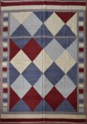 A Kilim with all over diamond design within a cube and banded border. L.239xW.179cm
