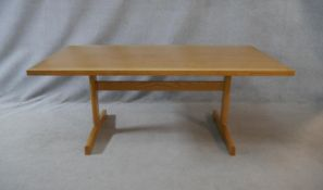 A Danish teak draw leaf dining table on platform base by Cado with maker's disc to the underside.