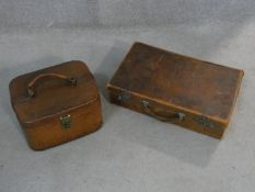 A vintage leather vanity case and a similar documents case. H.11 L.45 W.28cm