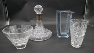 An Asprey & Co cut crystal ship's decanter with hallmarked silver collar along with three crystal