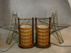A pair of gilt metal framed glazed star shaped candle holders and a pair of Chinese style table