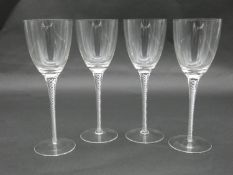 Four blown glass double air twist stem wine glasses with rounded feet. H.19cm