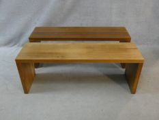 A pair of contemporary hardwood benches with planked top and supports. H.46.5 L.125.5 W.35cm