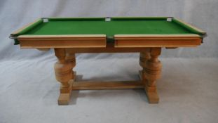 A mid century light oak framed half size snooker table converting to dining table with maker's