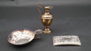 A collection of silver items. Including A miniature silver Grecian style water pitcher, a repousse