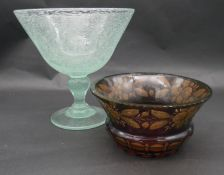 An antique Bohemian amber flashed ruby uranium cut glass bowl with engraved floral and foliate