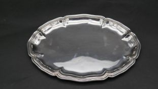 A Continental silver scalloped edge oval serving tray. Stamped 800 with a shield, 8122. Weight