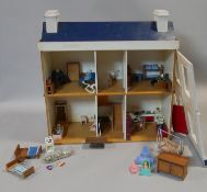 A vintage scratch built doll's house complete with furniture and effects. H.60 L.60 W.24cm