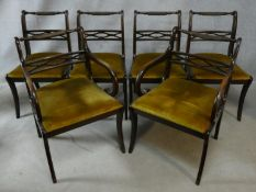A set of six Regency style mahogany dining chairs with ropetwist backs above drop in seats on