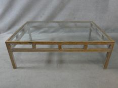 A limed oak coffee table with inset plate glass top. H.40 L.120 W.80cm