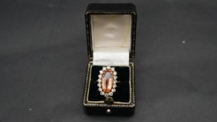 A vintage 18ct yellow gold topaz and diamond oval cluster dress ring. Set with an oval mixed cut