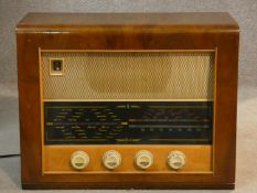 A vintage Bush walnut cased radio. With makers label. H.39 L.50 W.22cm