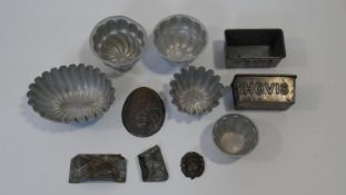 A collection of eleven antique and vintage metal chocolate, bread and jelly moulds. Including a