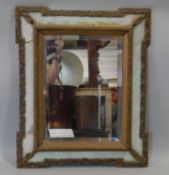 A 19th century gesso and painted wall mirror with glazed frame and original bevelled plate. H.60 W.