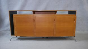 A contemporary bespoke commissioned sideboard in laqcuered and polished blondewood on metal base.