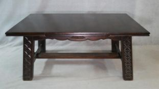 A vintage oak draw leaf dining table on carved square stretchered and pegged supports. H.76 L.267