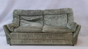 A mid century vintage two seater sofa. H.70 W.158 D.88cm