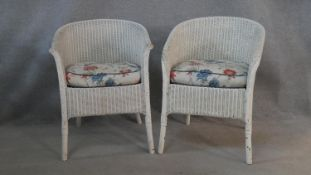 A pair of vintage Lloyd Loom woven tub armchairs with maker's label to the underside. H.68cm