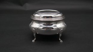 A Continental oval hinged lidded silver jewellery box on four hoof form legs. Stamped 800 with a